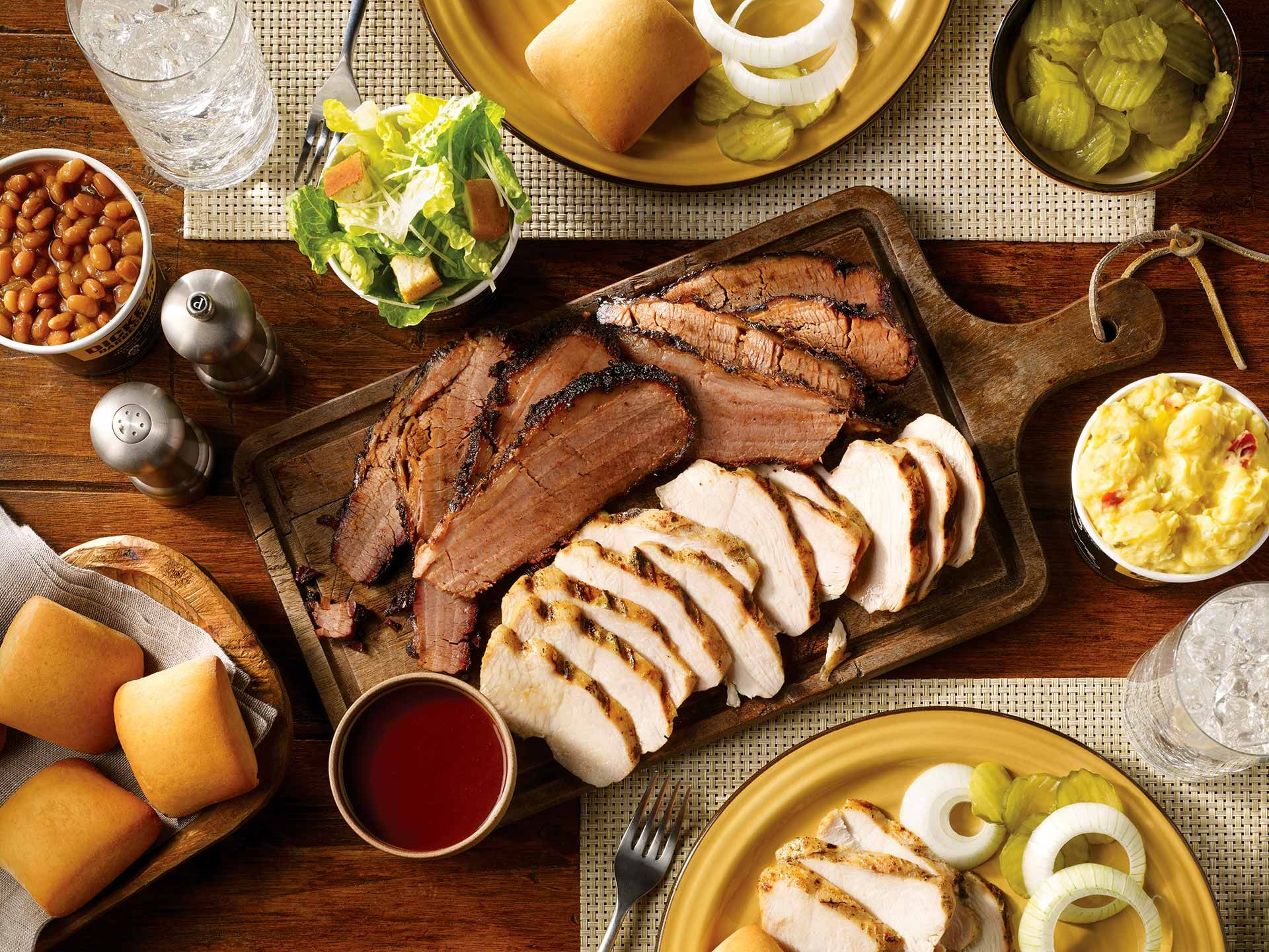 Image depicting delicious barbecue food laid down on the table
